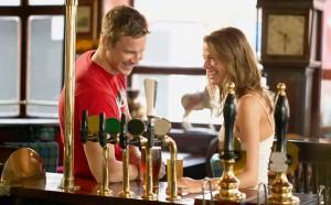 2-couple-flirting-at-bar-main